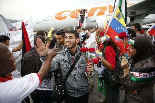 Palestinian students arrive at Simon Bolivar airport outside Caracas