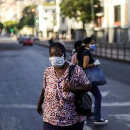 "A woman wears a face mask as a preventive measure against the spread of the new coronavirus, COVID-19, in Caracas, on March 17, 2020. - People in crisis-weary Caracas woke up Monday to a ""collective quarantine"" after President Nicolas Maduro ordered the Venezuelan capital's six million population to stay at home to curb the spread of the coronavirus. (Photo by Cristian HERNANDEZ / AFP)"